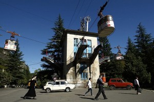 People pass a cable car station that is not running during a power cut in the town of Chiatura