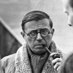 Lo scrittore alla Sorbona con il famoso giubbotto sciarpa e pipa